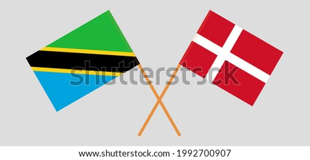 Crossed flags of Tanzania and Denmark. Official colors. Correct proportion