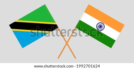 Crossed flags of Tanzania and India. Official colors. Correct proportion