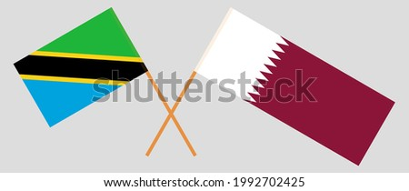 Crossed flags of Tanzania and Qatar. Official colors. Correct proportion