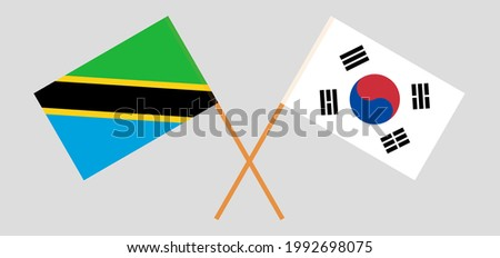 Crossed flags of Tanzania and South Korea. Official colors. Correct proportion