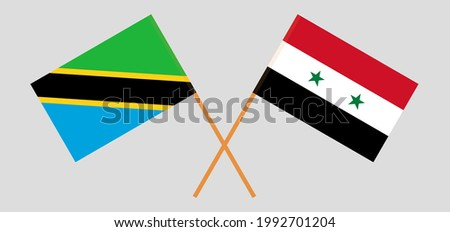 Crossed flags of Tanzania and Syria. Official colors. Correct proportion