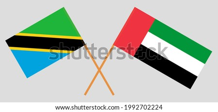 Crossed flags of Tanzania and the United Arab Emirates. Official colors. Correct proportion