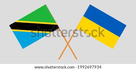 Crossed flags of Tanzania and Ukraine. Official colors. Correct proportion