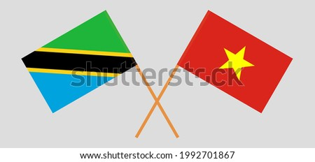 Crossed flags of Tanzania and Vietnam. Official colors. Correct proportion