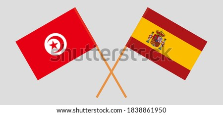 Crossed flags of Tunisia and Spain