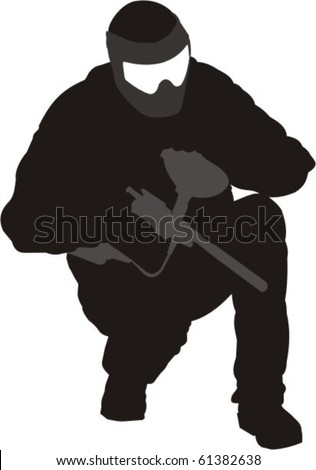 Crouching paintball player pauses to reload. - stock vector