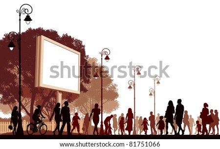 Crowd of people walking on a street