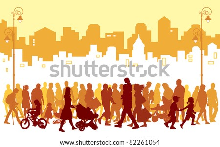 Crowd of people walking on a street.