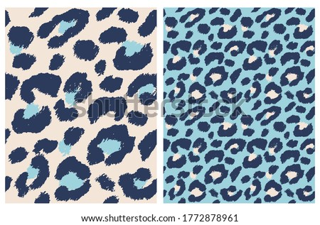 Cute Abstract Wild Animal Skin Vector Pattern. Dark Blue Brush Irregular Spots Isolated on a Cream and Light Blue Backgrounds. Leopard Skin Vector Print. Simple Wild Cat Fur Backdrop.