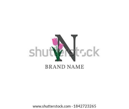 cute and clean romantic letter N tulip alphabet vintage logo for wedding initial, spa or beauty care brand name company and individuals freelancer or influencer Foto stock ©