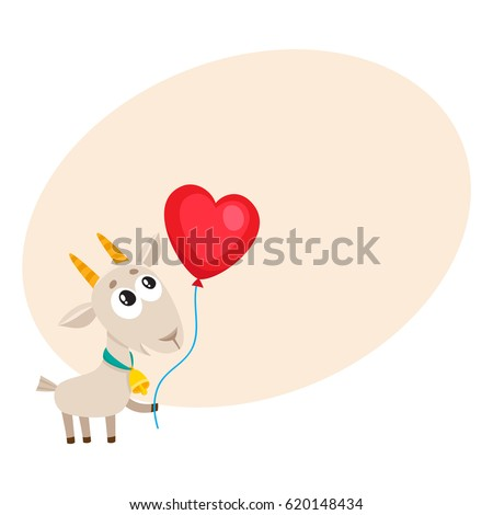 cute and funny goat holding red