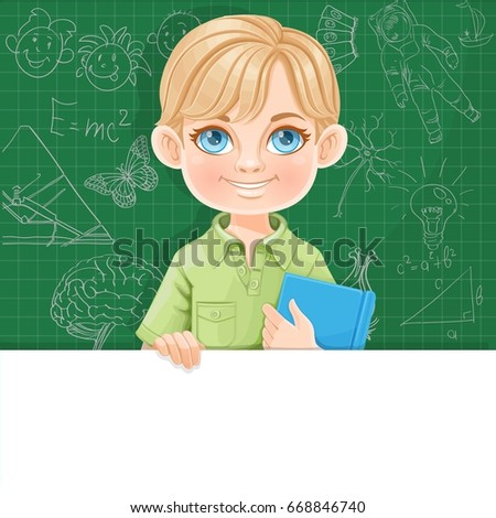 cute blond boy holds textbook