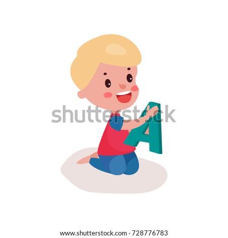 cute blonde little boy sitting