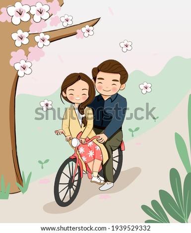 cute boy and girl biking