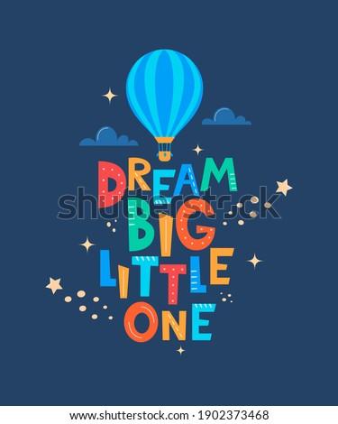 Cute cartoon print with aerostat and lettering Dream Big Little One. Cute design for children's fashion fabrics, textile graphics, prints. Motivaton slogan for kids. Vector illustration Stock photo ©