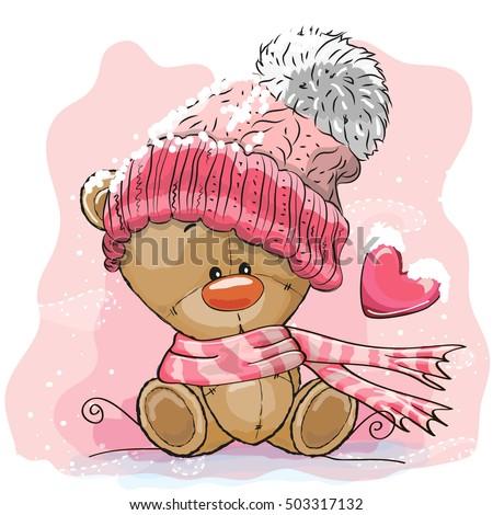 Stock Photo Cute Cartoon Teddy bear in a knitted cap sits on a snow