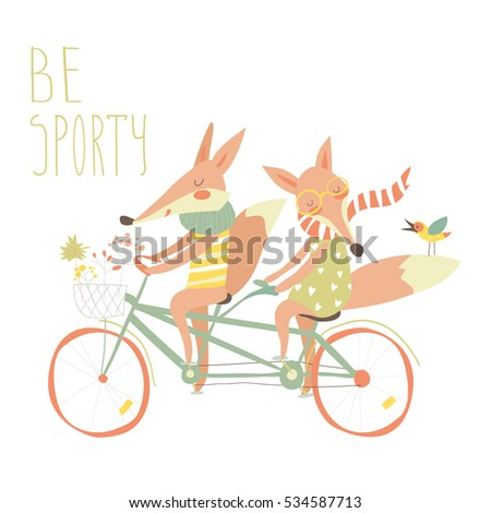 Cute couple foxes ride tandem bicycle