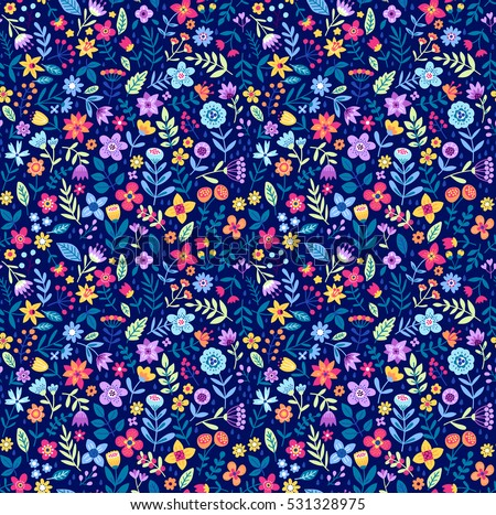 "Cute Floral pattern in the small flower. ""Ditsy print"". Motifs scattered random. Seamless vector texture. Elegant template for fashion prints. Printing with small colorful flowers. Blue background."