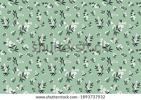 Cute floral pattern in the small flowers. Seamless vector texture. Elegant template for fashion prints. Printing with small white flowers. Light green background. Stock.