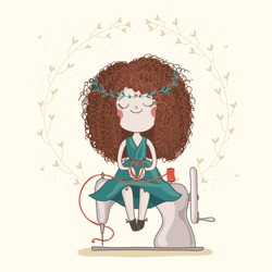 Cute girl in green dress with fluffy red haircut is sitting on the sewing machine and holding heart from thread. Hand made or DIY character