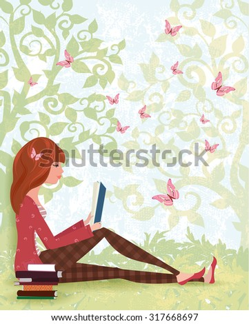 cute girl is reading a book