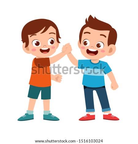 cute happy kid hand shake with friend Stock foto ©