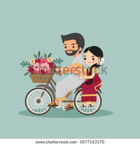cute indian couple with bicycle