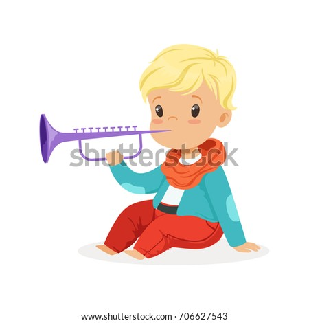 cute little blonde boy playing