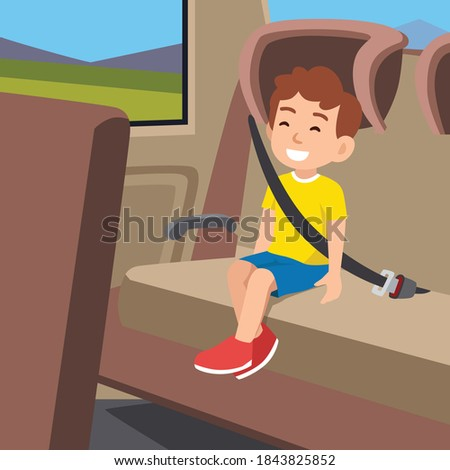 Cute little boy smiling and sitting on the back seat of car Foto stock ©