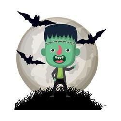 cute little boy with frankenstein costume in dark night scene