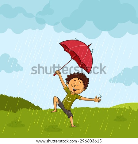 Cute little boy with umbrella, dancing and enjoying in rains on nature background.