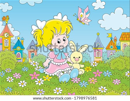 Cute little girl in a beautiful pink dress sitting with a small toy rabbit among flowers on a green lawn against a background of colorful houses of a small town, vector cartoon illustration Stock photo ©