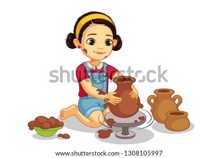Cute little girl making pottery on wheel