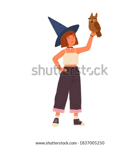 Cute little wizard holding magical owl vector flat illustration. Smiling female child demonstrating fairy animal isolated on white. Happy girl sorcerer wearing witch hat standing with magic bird Сток-фото ©