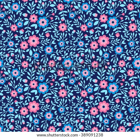Cute pattern in small flower. Small colorful flowers. Blue background. Floral seamless pattern. Small cute simple spring flowers. Design concept for fashion textile print.