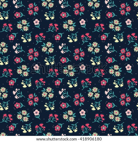 Cute pattern in small flower. Small colorful flowers. Dark blue background. Spring floral background. The elegant the template for fashion prints.