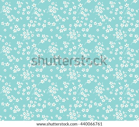 Cute pattern in small flower. Small white flowers. Blue background. Ditsy floral background. The elegant the template for fashion prints.