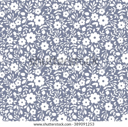 Cute pattern in small flower. Small white flowers. Gray background. Floral seamless pattern. Small cute simple spring flowers.