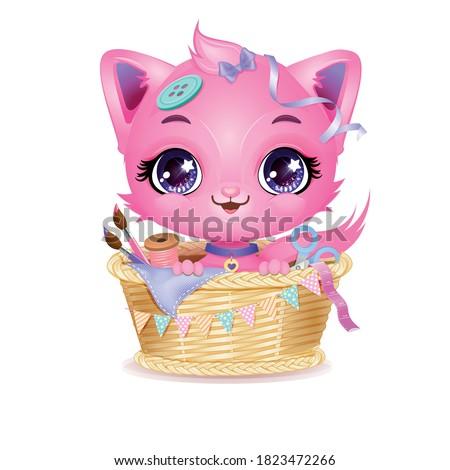 cute pink kitten in sewing