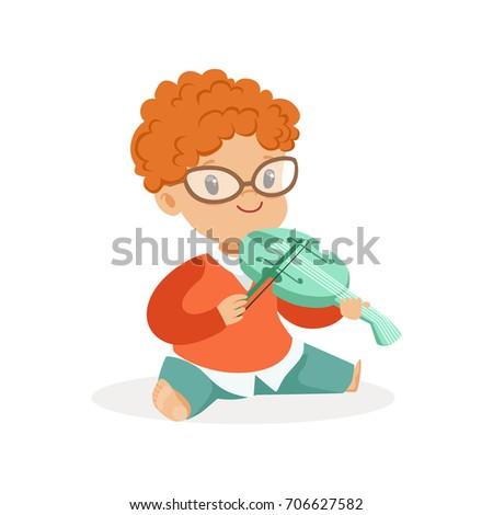 cute redhead little boy playing