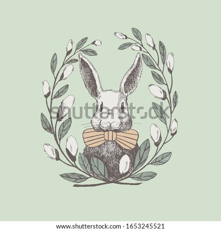 Cute white rabbit in a frame of willow twigs. Vector spring holiday greeting poster design element. Vintage illustration of a funny hare. Cozy design of an Easter card.