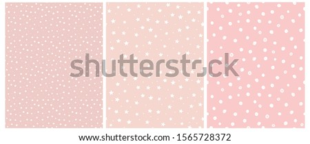 Cute White Stars and Dots Seamless Vector Patterns. Tiny Stars Isolated on a Pink Background.Light Pastel Pink Simple Infantile Sky Design.Delicate Dotted Vector Print Ideal for Fabric, Card, Layout.