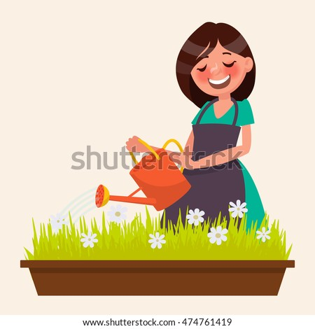 cute woman is watering the