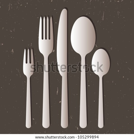 Cutlery on gray background