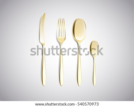 Cutlery Set of Golden Forks Spoons and Knifes Top View Isolated on White Background. Table Setting.