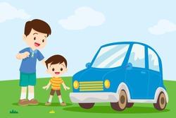 Dad and son looking at car.