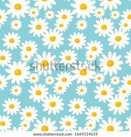 Daisy flower seamless pattern on blue background. Ditsy floral print with tiny chamomile great for fashion fabric, home decor textile and wallpaper. Vector
