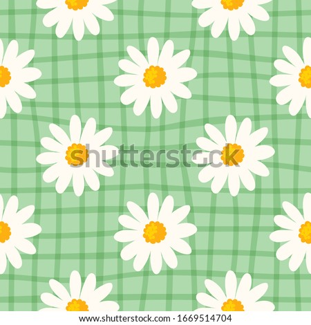 Daisy seamless pattern  on hand drawn checked background. Floral ditsy print with small white flowers and leaves. Chamomile trend design great for fashion fabric, kitchen textile and wallpaper. Vector