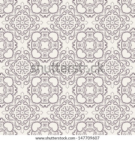 Damask seamless pattern symmetrical texture with hearts and wings