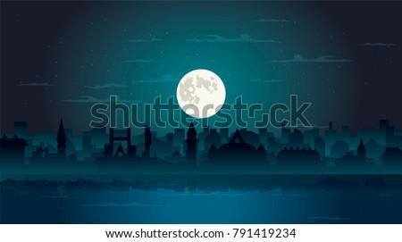 dark ciryscape  full moon in